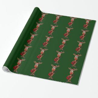 Rudolph jouant le papier d'emballage de guitare papier cadeau