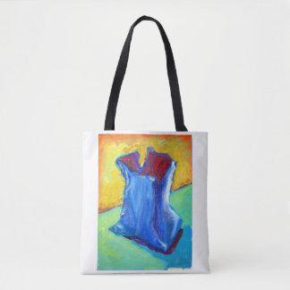 Sac bleu sur un autre sac