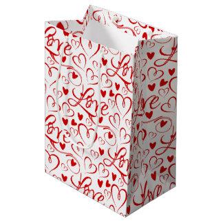 Sac Cadeau Moyen Amour cursif et tissu rouge de Saint-Valentin de