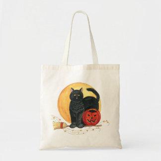 Sac de chat noir et de balai de lune d'or de