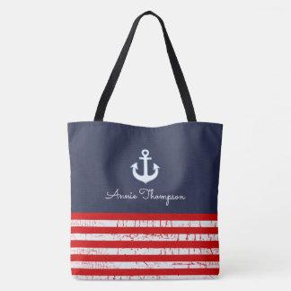 sac fourre-tout rouge et bleu à marine avec le nom