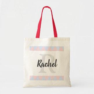 sac nommé initial de couleurs en pastel