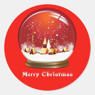 Scène de village de globe de neige de Noël Sticker Rond