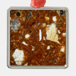 Section mince d'une brique sous le microscope ornement carré argenté