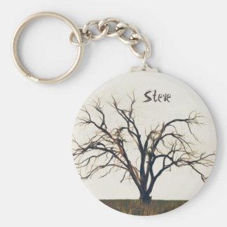 Seul un arbre nu avec de grandes branches tordues porte-clés