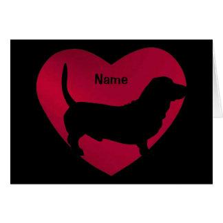 Silhouette de basset au coeur rouge carte de vœux