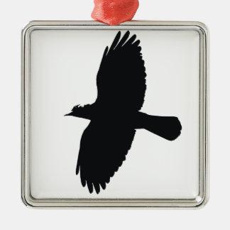 Silhouette de choucas en vol ornement carré argenté