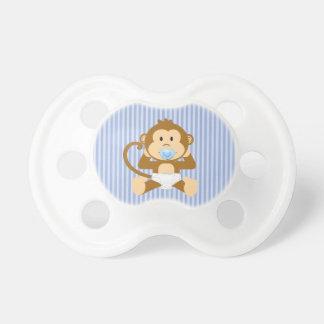Singe de bébé dans la tétine de couche-culotte