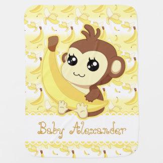 Singe mignon de Kawaii tenant la banane Couverture Pour Bébé