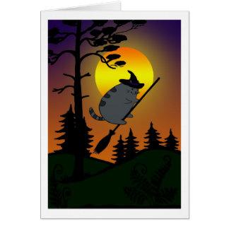 Sorcière de Halloween pilotant une carte de balai