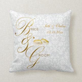Souvenir blanc de mariage de damassé et d'or oreillers