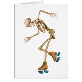 Squelette sur des patins de rouleau carte