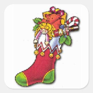 Sticker Carré Noël vintage stockant complètement des jouets