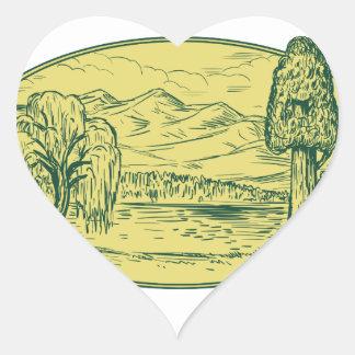 Sticker Cœur Ovale Drawin de montagnes de lac tree de saule et