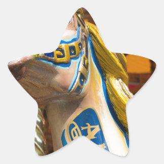 Sticker Étoile Cheval de carrousel sur le joyeux goround