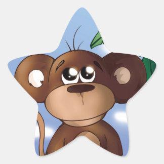 Sticker Étoile Petit singe mignon se reposant à côté du bananier