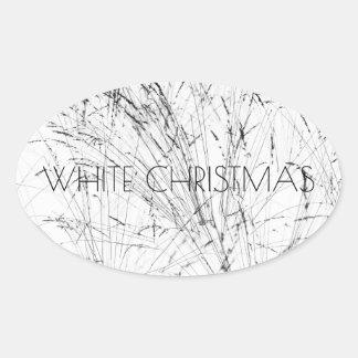 Sticker Ovale Herbe d'hiver dans la neige