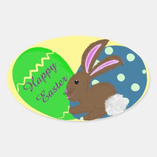 Sticker Ovale Oeufs de pâques de vert bleu de lapin de Pâques