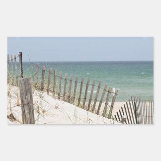Sticker Rectangulaire Vue d'océan par la barrière de plage
