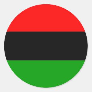 Sticker Rond Afro-américain afro-américain de drapeau