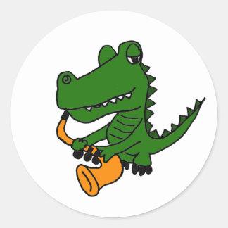 Sticker Rond AO alligator jouant le saxophone