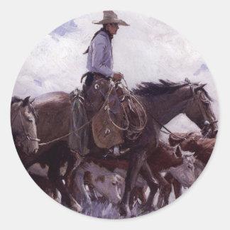 Sticker Rond Cowboy vintage avec son troupeau de bétail par