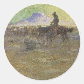 Sticker Rond Cowboy vivant en troupe des bétail sur la gamme