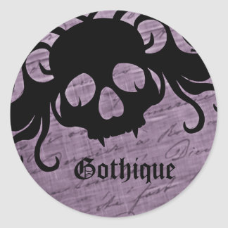Sticker Rond Gothic purple and black fanged skull