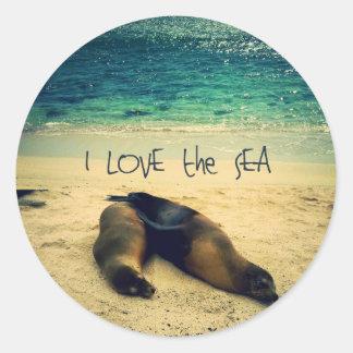 Sticker Rond J'aime la plage de citation de mer avec des