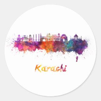 Sticker Rond Karachi skyline in watercolor