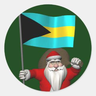 Sticker Rond Le père noël avec le drapeau des Bahamas