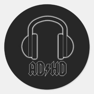 Sticker Rond Les écouteurs de TDAH soutiennent dans
