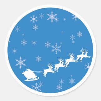 Sticker Rond Noël de Père Noël avec le renne