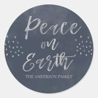 Sticker Rond Paix sur la photo bleue et argentée de la terre