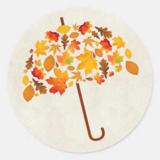 Sticker Rond Parapluie d'automne avec le feuille