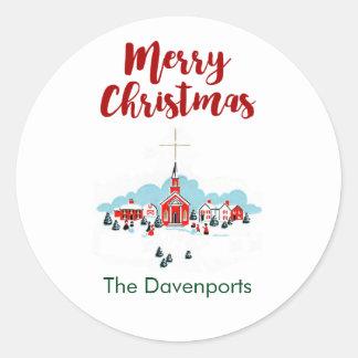 Sticker Rond Scène de Noël avec une église et une étoile rouges