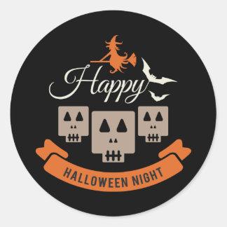 Sticker Rond Sorcière éffrayante et crânes de Halloween