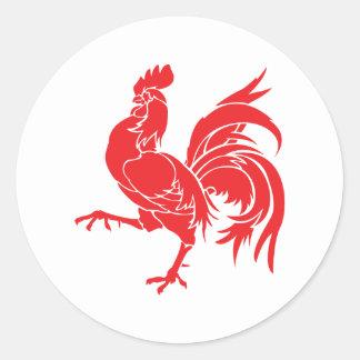Sticker Rond Un coq rouge