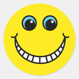 Sticker Rond Visage souriant de grimacerie jaune