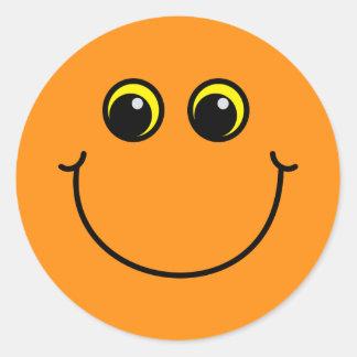 Sticker Rond Visage souriant orange