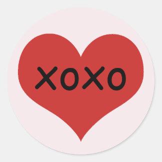 Sticker Rond Xoxo rouge traditionnel de l'arrière - plan   de