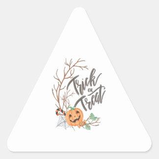 Sticker Triangulaire Illustration de des bonbons ou un sort