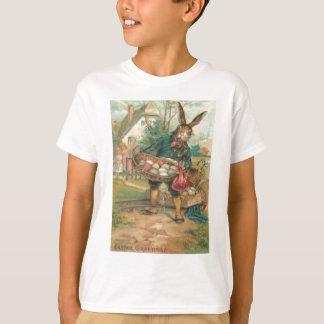 T-shirt Chariot coloré peint d'enfants d'oeufs de lapin de