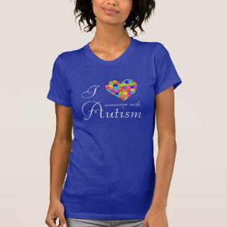 """T-shirt """"J'aime quelqu'un des morceaux avec d'autisme"""""""