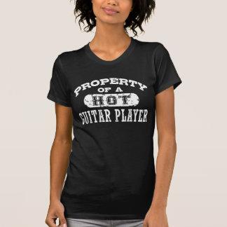 T-shirt Propriété d'un joueur de guitare chaud
