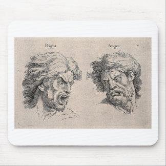 Tapis De Souris Deux dessins des visages fâchés