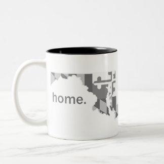 Tasse à la maison à fond gris de drapeau du