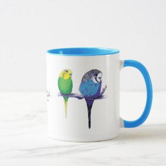 Tasse bleue d'oiseau de perroquet de perruche