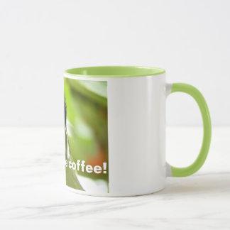 Tasse de café verte tropicale d'oiseau