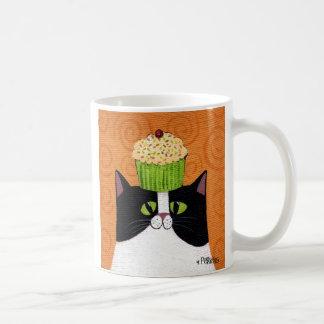 Tasse de chat de petit gâteau